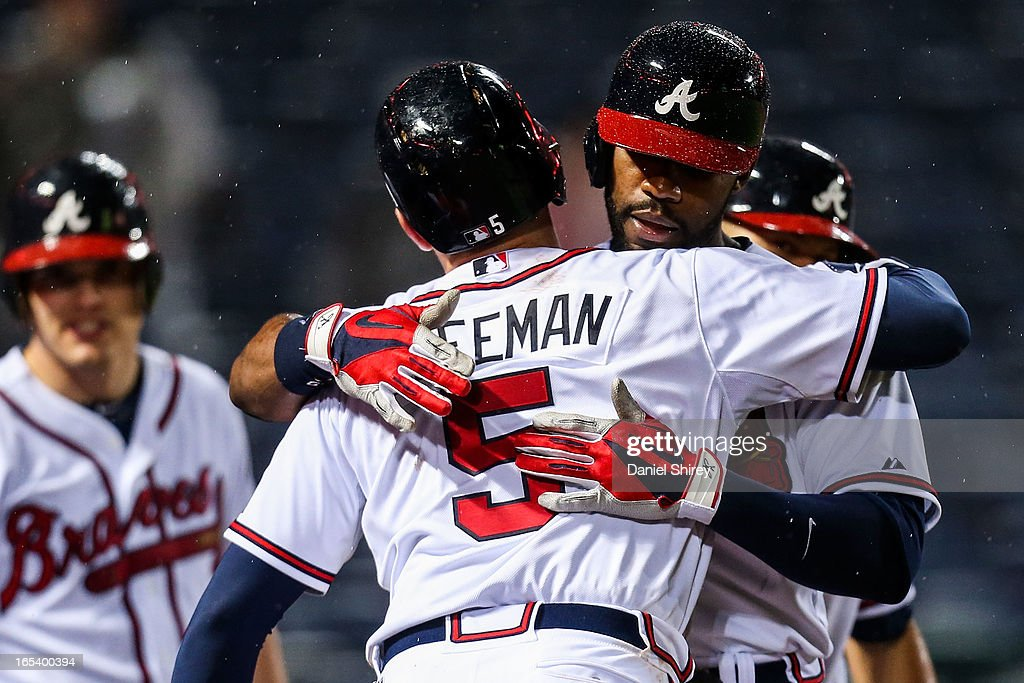 <a gi-track='captionPersonalityLinkClicked' href=/galleries/search?phrase=Jason+Heyward&family=editorial&specificpeople=5043351 ng-click='$event.stopPropagation()'>Jason Heyward</a> #22 celebrates a two-run home run with <a gi-track='captionPersonalityLinkClicked' href=/galleries/search?phrase=Freddie+Freeman&family=editorial&specificpeople=5743987 ng-click='$event.stopPropagation()'>Freddie Freeman</a> #5 of the Atlanta Braves in the eighth inning of the game against the Philadelphia Phillies at Turner Field on April 3, 2013 in Atlanta, Georgia.