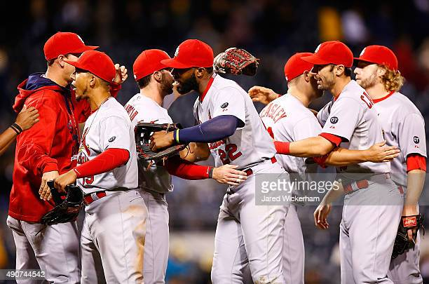 Jason Heyward Jon Jay and Matt Carpenter of the St Louis Cardinals congratulate teammates following their division clinching 111 win against the...
