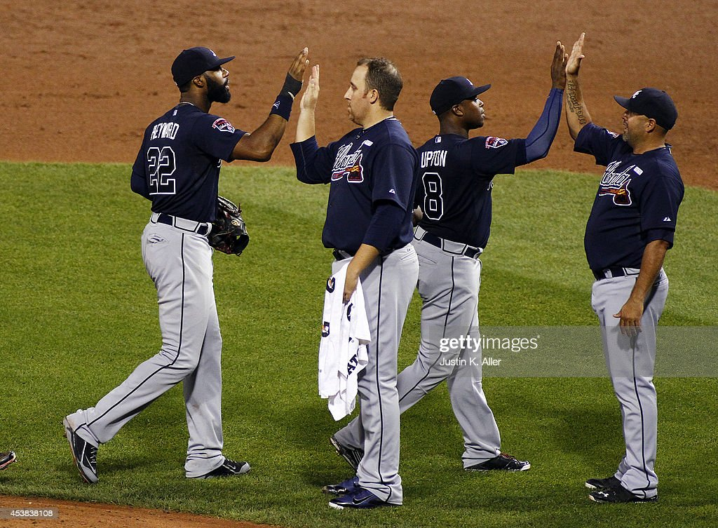 <a gi-track='captionPersonalityLinkClicked' href=/galleries/search?phrase=Jason+Heyward&family=editorial&specificpeople=5043351 ng-click='$event.stopPropagation()'>Jason Heyward</a> #22 of the Atlanta Braves and <a gi-track='captionPersonalityLinkClicked' href=/galleries/search?phrase=Justin+Upton&family=editorial&specificpeople=846265 ng-click='$event.stopPropagation()'>Justin Upton</a> #8 celebrate with teammates after defeating the Pittsburgh Pirates 11-3 at PNC Park on August 19, 2014 in Pittsburgh, Pennsylvania.