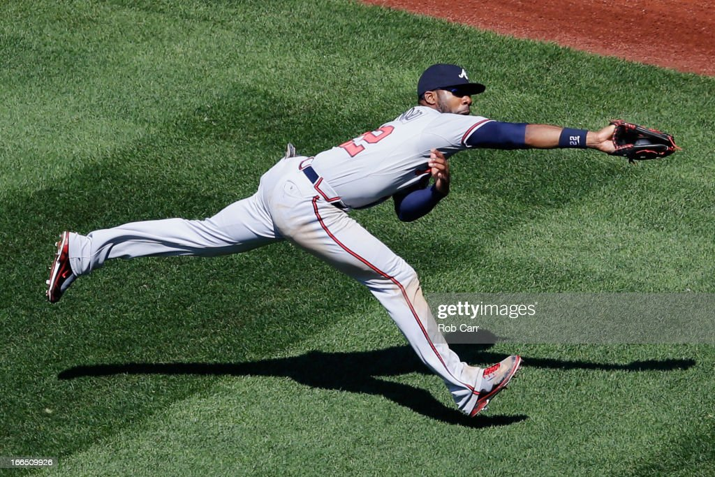 <a gi-track='captionPersonalityLinkClicked' href=/galleries/search?phrase=Jason+Heyward&family=editorial&specificpeople=5043351 ng-click='$event.stopPropagation()'>Jason Heyward</a> #22 of the Atlanta Braves catches a ball hit by Adam LaRoche #25 of the Washington Nationals for the third out of the seventh inning during the Braves 3-1 win at Nationals Park on April 13, 2013 in Washington, DC.