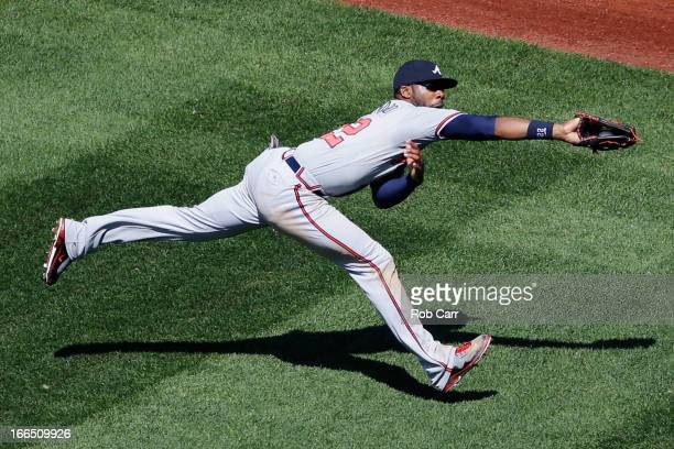 Jason Heyward of the Atlanta Braves catches a ball hit by Adam LaRoche of the Washington Nationals for the third out of the seventh inning during the...