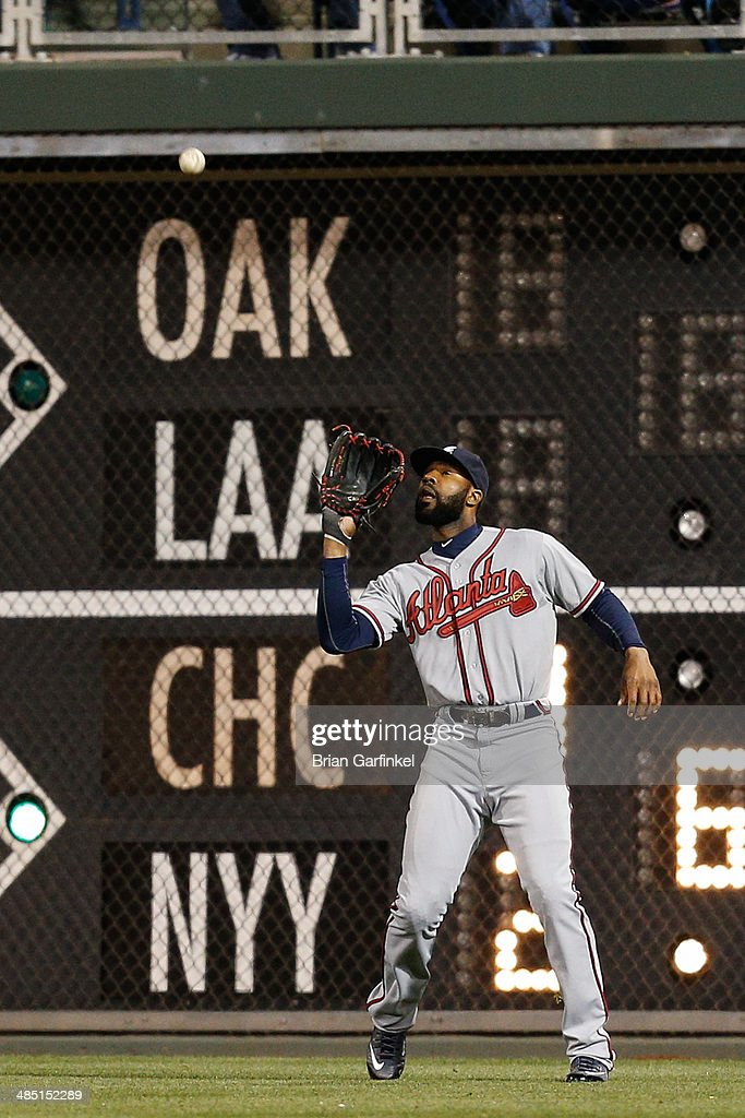 <a gi-track='captionPersonalityLinkClicked' href=/galleries/search?phrase=Jason+Heyward&family=editorial&specificpeople=5043351 ng-click='$event.stopPropagation()'>Jason Heyward</a> of the Atlanta Braves catches a long fly ball hit by Marlon Byrd of the Philadelphia Phillies in the eighth inning of the game at Citizens Bank Park on April 16, 2014 in Philadelphia, Pennsylvania. All uniformed team members are wearing jersey number 42 in honor of Jackie Robinson Day. The Braves won 1-0.
