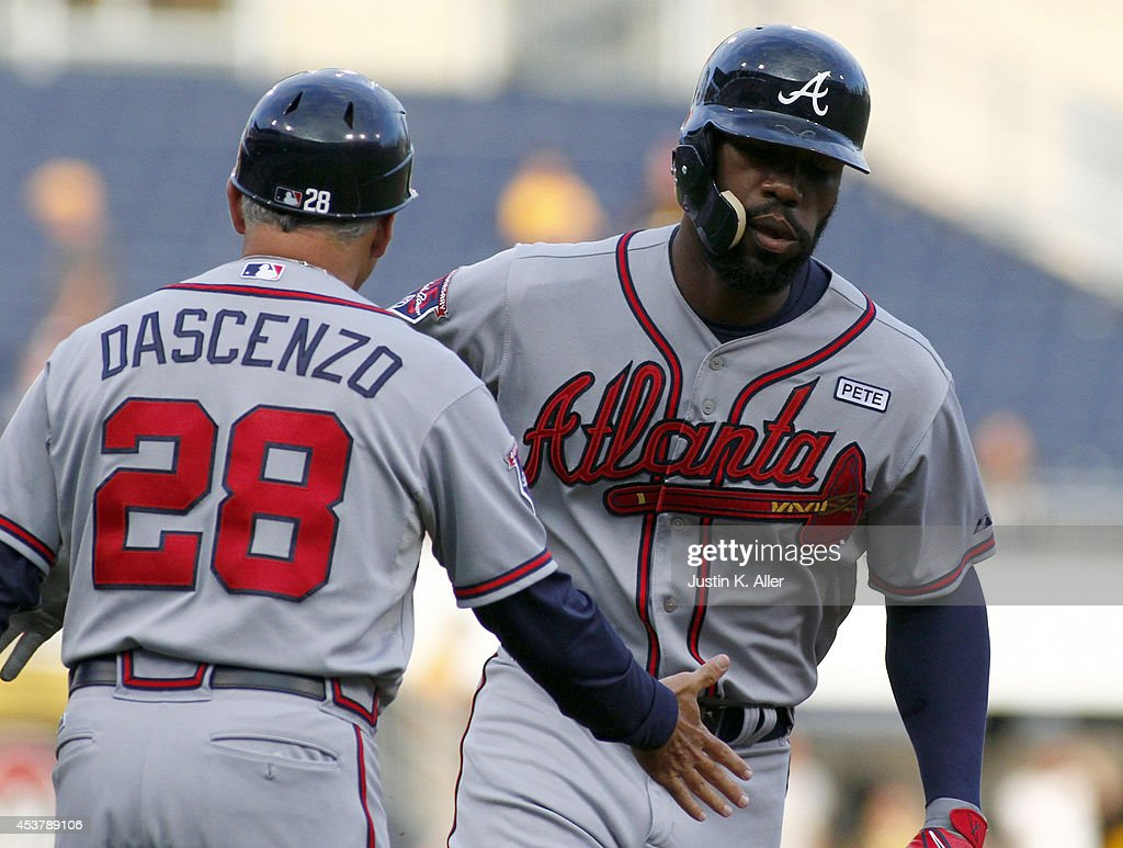 <a gi-track='captionPersonalityLinkClicked' href=/galleries/search?phrase=Jason+Heyward&family=editorial&specificpeople=5043351 ng-click='$event.stopPropagation()'>Jason Heyward</a> #22 of the Atlanta Braves celebrates with base coach Doug Dascenzo #28 after hitting a home run in the first inning against the Pittsburgh Pirates during the game at PNC Park on August 18, 2014 in Pittsburgh, Pennsylvania.