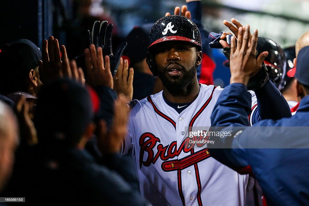 Jason Heyward #22 of the Atlanta Braves celebrates with teammates after scoring in the fourth inning of the game against the Philadelphia Phillies at Turner Field on April 3, 2013 in Atlanta, Georgia.