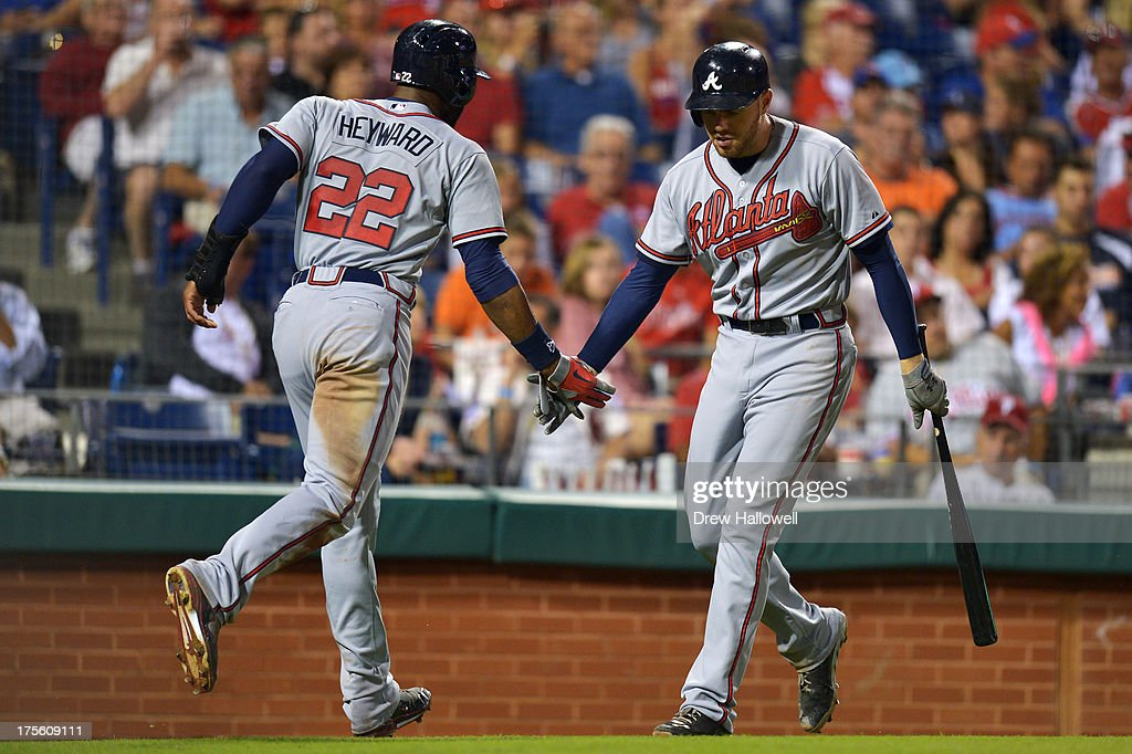 <a gi-track='captionPersonalityLinkClicked' href=/galleries/search?phrase=Jason+Heyward&family=editorial&specificpeople=5043351 ng-click='$event.stopPropagation()'>Jason Heyward</a> #22 of the Atlanta Braves gets congratulated by teammate <a gi-track='captionPersonalityLinkClicked' href=/galleries/search?phrase=Freddie+Freeman&family=editorial&specificpeople=5743987 ng-click='$event.stopPropagation()'>Freddie Freeman</a> #5 on scoring a run in the fourth inning against the Philadelphia Phillies at Citizens Bank Park on August 4, 2013 in Philadelphia, Pennsylvania.