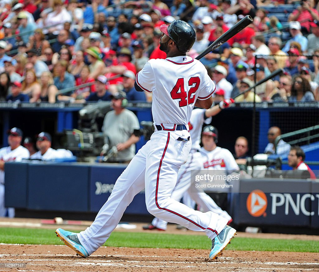 <a gi-track='captionPersonalityLinkClicked' href=/galleries/search?phrase=Jason+Heyward&family=editorial&specificpeople=5043351 ng-click='$event.stopPropagation()'>Jason Heyward</a> of the Atlanta Braves hits a fourth inning home run against the Milwaukee Brewers at Turner Field on April 15, 2012 in Atlanta, Georgia. All uniformed team members are wearing jersey number 42 in honor of Jackie Robinson Day.
