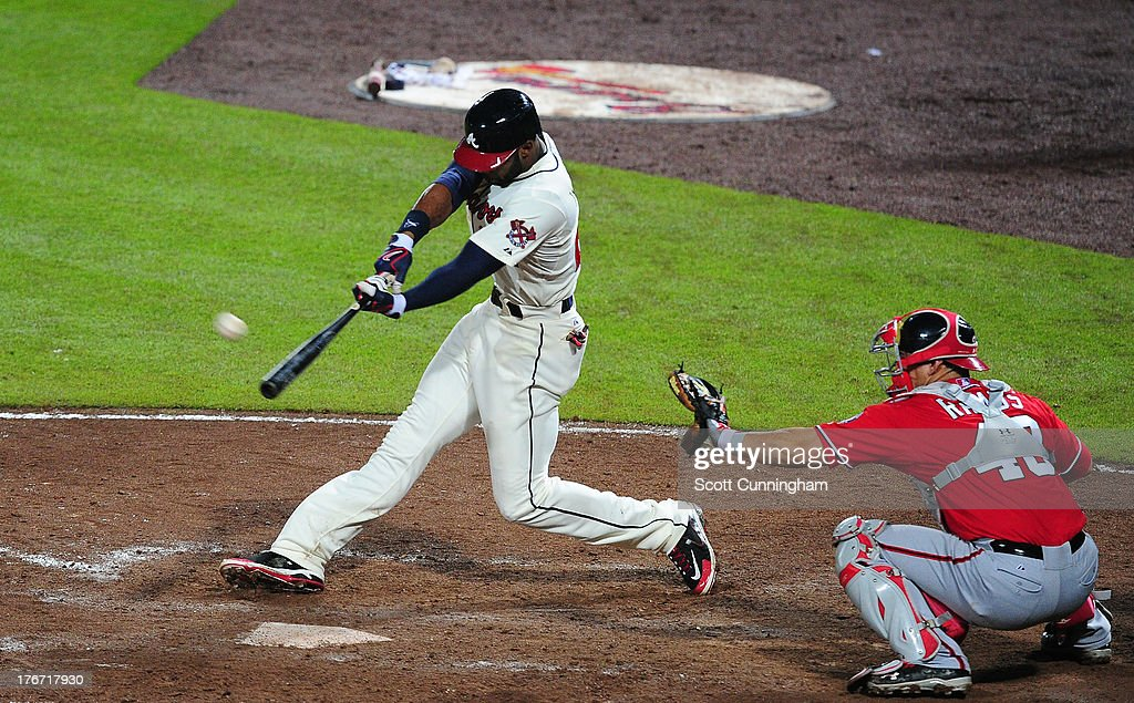 <a gi-track='captionPersonalityLinkClicked' href=/galleries/search?phrase=Jason+Heyward&family=editorial&specificpeople=5043351 ng-click='$event.stopPropagation()'>Jason Heyward</a> #22 of the Atlanta Braves hits a two-run ninth inning home run to tie the game against the Washington Nationals at Turner Field on August 17, 2013 in Atlanta, Georgia.
