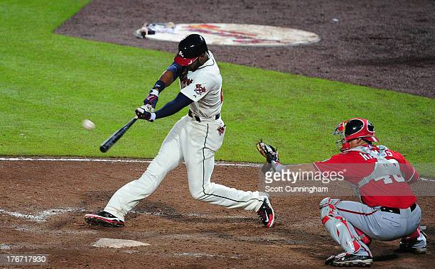 Jason Heyward of the Atlanta Braves hits a tworun ninth inning home run to tie the game against the Washington Nationals at Turner Field on August 17...