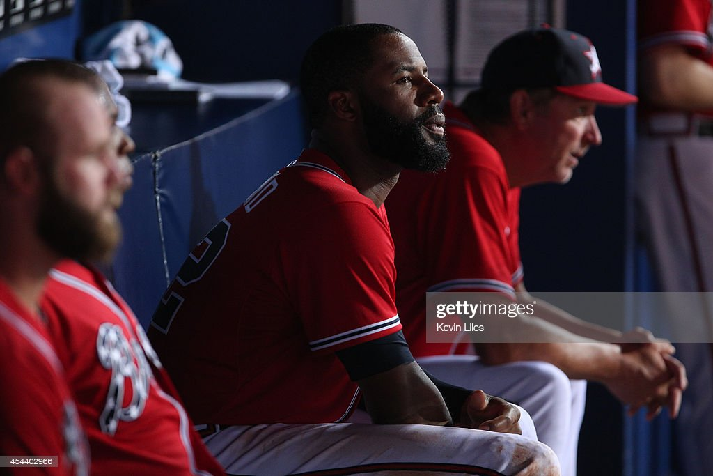 <a gi-track='captionPersonalityLinkClicked' href=/galleries/search?phrase=Jason+Heyward&family=editorial&specificpeople=5043351 ng-click='$event.stopPropagation()'>Jason Heyward</a> #22 of the Atlanta Braves (center) in the dugout against the Miami Marlins during the ninth inning at Turner Field on August 30, 2014 in Atlanta, Georgia.