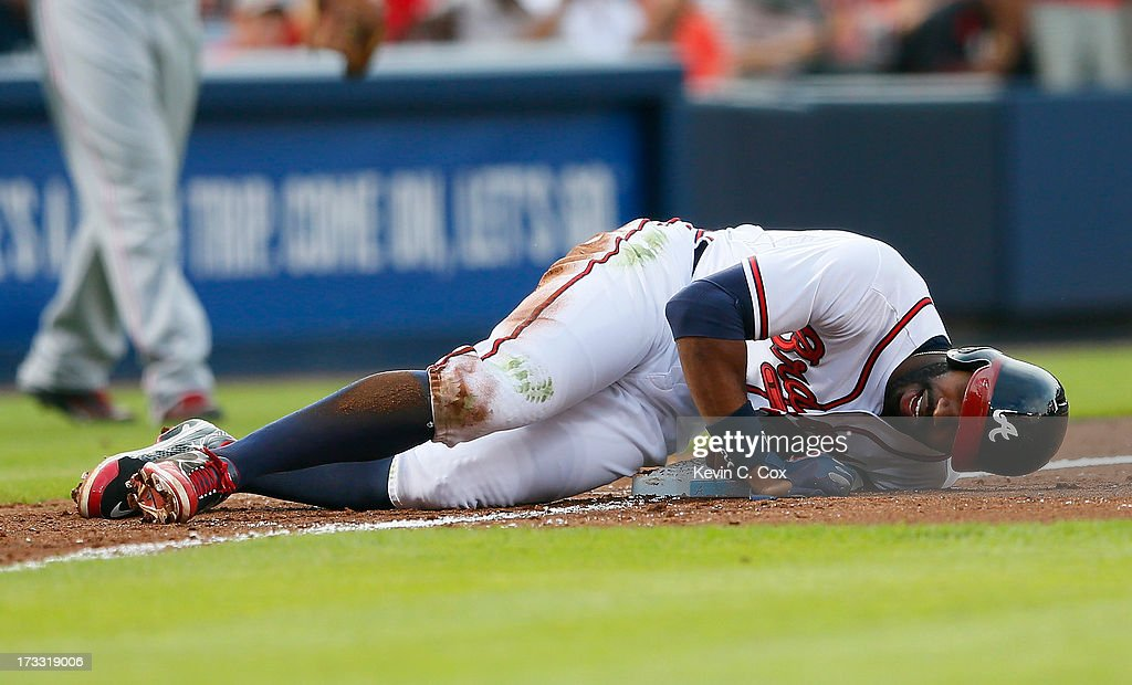 <a gi-track='captionPersonalityLinkClicked' href=/galleries/search?phrase=Jason+Heyward&family=editorial&specificpeople=5043351 ng-click='$event.stopPropagation()'>Jason Heyward</a> #22 of the Atlanta Braves injures himself as he slides into third base in the second inning against the Cincinnati Reds at Turner Field on July 11, 2013 in Atlanta, Georgia.