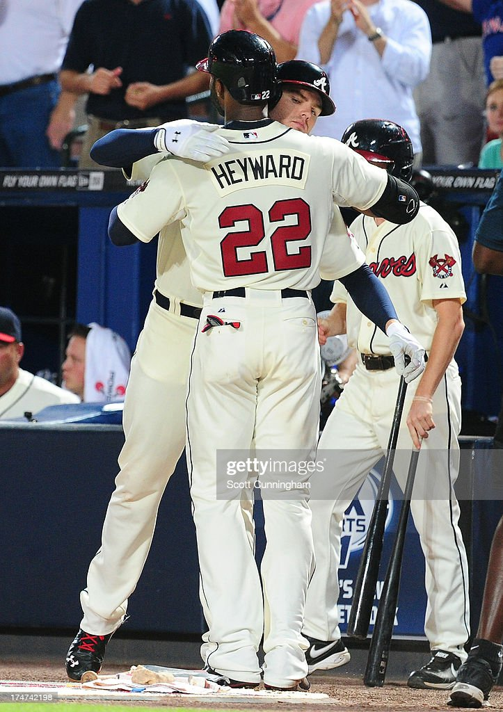 <a gi-track='captionPersonalityLinkClicked' href=/galleries/search?phrase=Jason+Heyward&family=editorial&specificpeople=5043351 ng-click='$event.stopPropagation()'>Jason Heyward</a> #22 of the Atlanta Braves is congratulated by <a gi-track='captionPersonalityLinkClicked' href=/galleries/search?phrase=Freddie+Freeman&family=editorial&specificpeople=5743987 ng-click='$event.stopPropagation()'>Freddie Freeman</a> #5 after hitting a third inning home run against the St. Louis Cardinals at Turner Field on July 28, 2013 in Atlanta, Georgia.