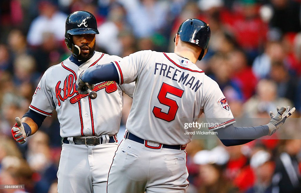 <a gi-track='captionPersonalityLinkClicked' href=/galleries/search?phrase=Jason+Heyward&family=editorial&specificpeople=5043351 ng-click='$event.stopPropagation()'>Jason Heyward</a> #22 of the Atlanta Braves is congratulated by teammate <a gi-track='captionPersonalityLinkClicked' href=/galleries/search?phrase=Freddie+Freeman&family=editorial&specificpeople=5743987 ng-click='$event.stopPropagation()'>Freddie Freeman</a> #5 after hitting a solo home run in the third inning against the Boston Red Sox during the game at Fenway Park on May 29, 2014 in Boston, Massachusetts.