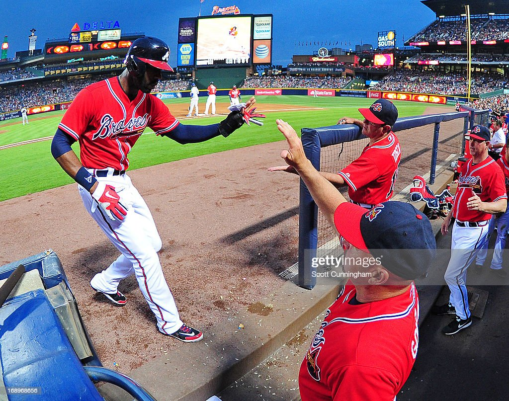 <a gi-track='captionPersonalityLinkClicked' href=/galleries/search?phrase=Jason+Heyward&family=editorial&specificpeople=5043351 ng-click='$event.stopPropagation()'>Jason Heyward</a> #22 of the Atlanta Braves is congratulated by teammates after scoring a third-inning run against the Los Angeles Dodgers at Turner Field on May 17, 2013 in Atlanta, Georgia.