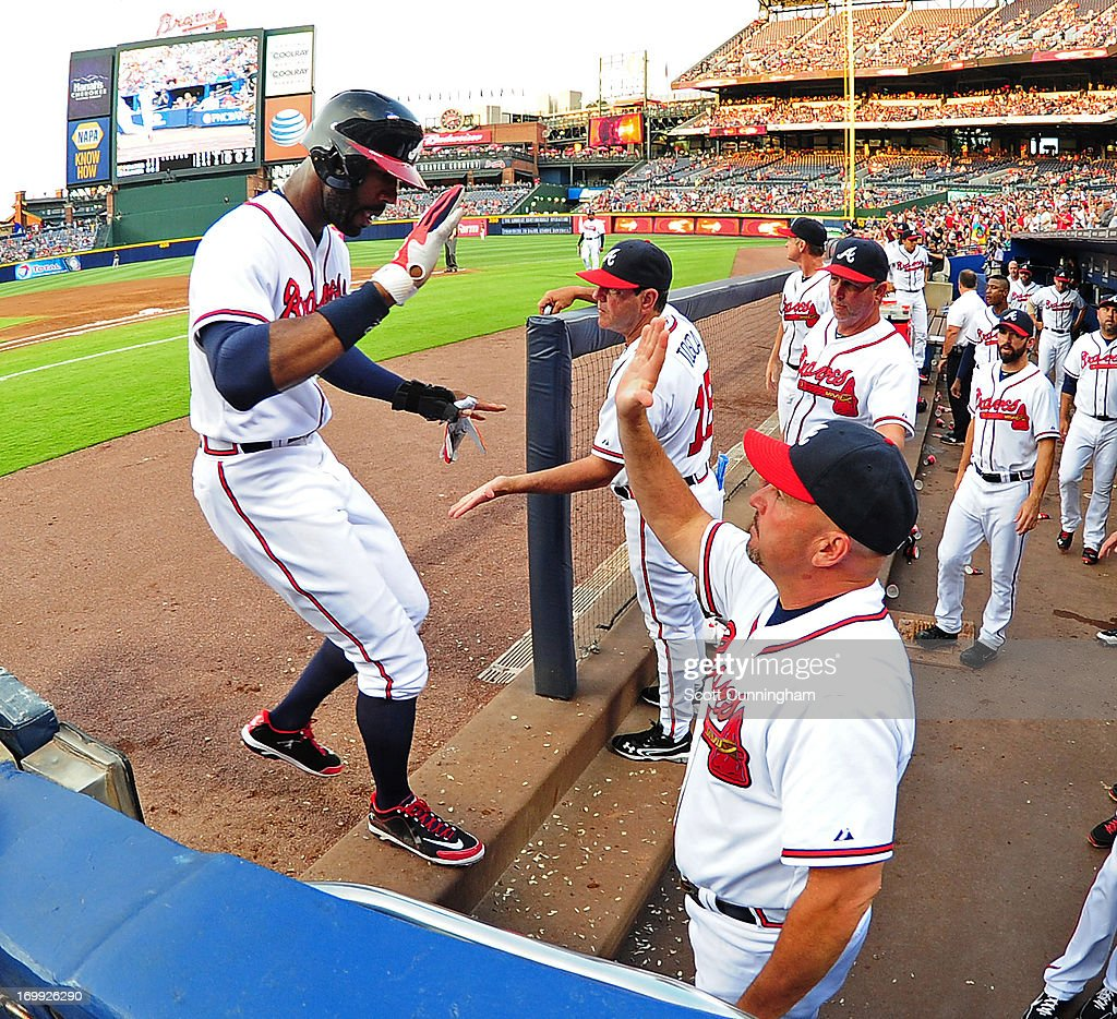 <a gi-track='captionPersonalityLinkClicked' href=/galleries/search?phrase=Jason+Heyward&family=editorial&specificpeople=5043351 ng-click='$event.stopPropagation()'>Jason Heyward</a> #22 of the Atlanta Braves is congratulated by teammates after scoring a third inning run against the Pittsburgh Pirates at Turner Field on June 4, 2013 in Atlanta, Georgia.