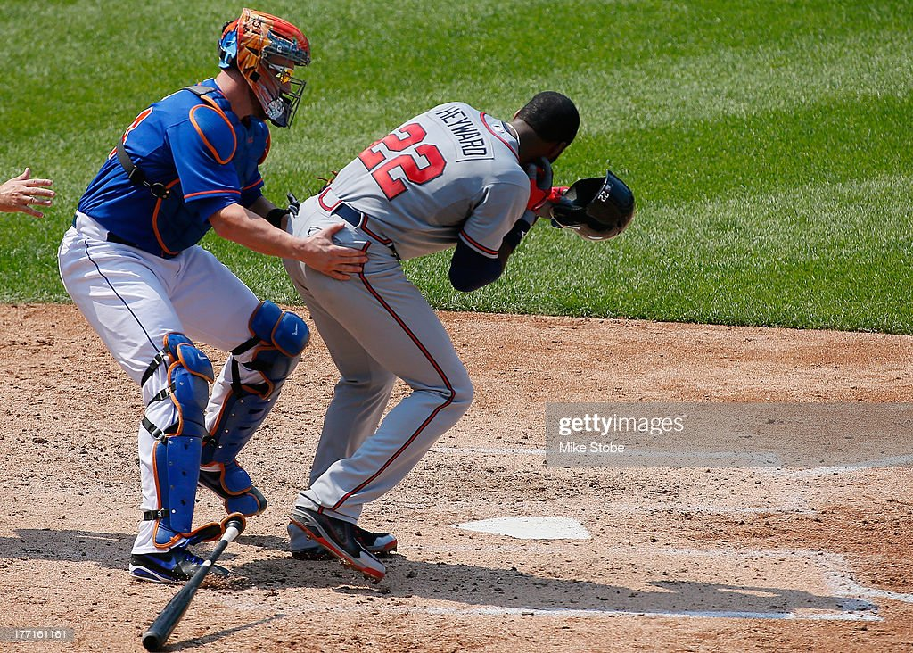 <a gi-track='captionPersonalityLinkClicked' href=/galleries/search?phrase=Jason+Heyward&family=editorial&specificpeople=5043351 ng-click='$event.stopPropagation()'>Jason Heyward</a> #22 of the Atlanta Braves is helped by <a gi-track='captionPersonalityLinkClicked' href=/galleries/search?phrase=John+Buck&family=editorial&specificpeople=213730 ng-click='$event.stopPropagation()'>John Buck</a> #44 of the New York Mets after getting hit in the face with a pitch from Jonathon Niese #49 in the fifth inning at Citi Field on August 21, 2013 at Citi Field in the Flushing neighborhood of the Queens borough of New York City.