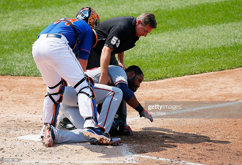 <a gi-track='captionPersonalityLinkClicked' href=/galleries/search?phrase=Jason+Heyward&family=editorial&specificpeople=5043351 ng-click='$event.stopPropagation()'>Jason Heyward</a> #22 of the Atlanta Braves is helped by <a gi-track='captionPersonalityLinkClicked' href=/galleries/search?phrase=John+Buck&family=editorial&specificpeople=213730 ng-click='$event.stopPropagation()'>John Buck</a> #44 of the New York Mets and homeplate umpire <a gi-track='captionPersonalityLinkClicked' href=/galleries/search?phrase=Greg+Gibson&family=editorial&specificpeople=228434 ng-click='$event.stopPropagation()'>Greg Gibson</a> #53 after getting hit in the face with a pitch from Jonathon Niese #49 in the fifth inning at Citi Field on August 21, 2013 at Citi Field in the Flushing neighborhood of the Queens borough of New York City.