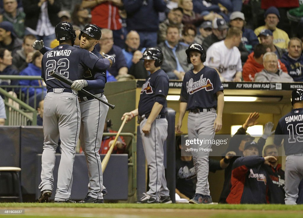 <a gi-track='captionPersonalityLinkClicked' href=/galleries/search?phrase=Jason+Heyward&family=editorial&specificpeople=5043351 ng-click='$event.stopPropagation()'>Jason Heyward</a> #22 of the Atlanta Braves is hugged by teammate <a gi-track='captionPersonalityLinkClicked' href=/galleries/search?phrase=Freddie+Freeman&family=editorial&specificpeople=5743987 ng-click='$event.stopPropagation()'>Freddie Freeman</a> #5 after Heyward's two run home run against Milwaukee Brewers in the fifth inning of a game at Miller Park on April 1, 2014 in Milwaukee, Wisconsin.