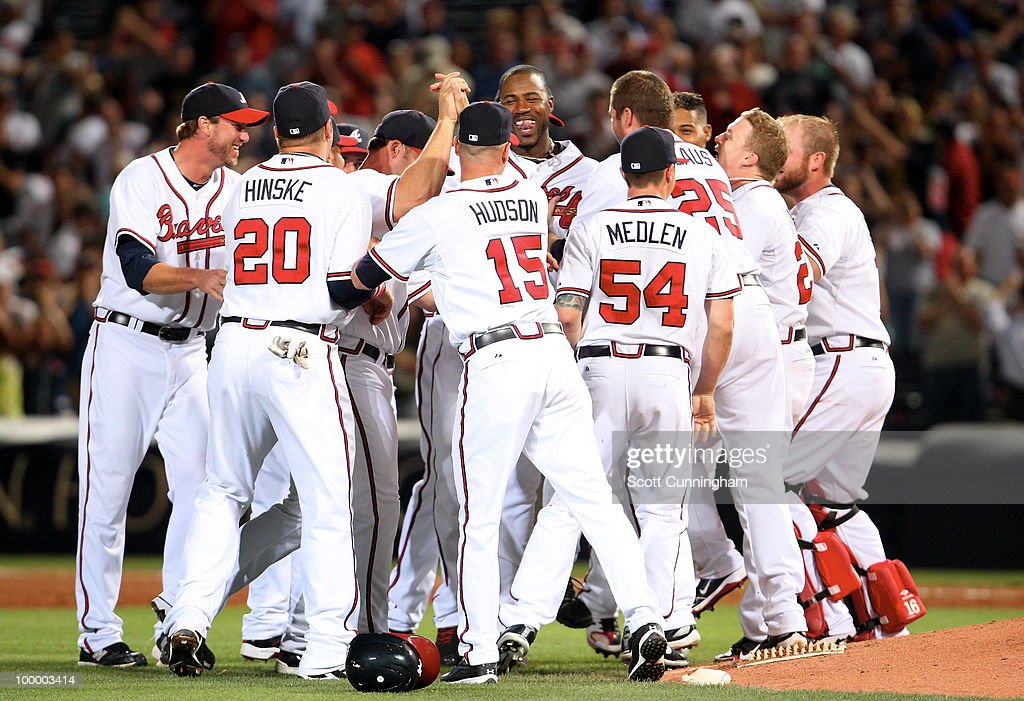 Jason Heyward #22 of the Atlanta Braves is mobbed by teammates after knocking in the game-winning run against the Cincinnati Reds at Turner Field on May 19, 2010 in Atlanta, Georgia. The Braves defeated the Reds 5-4.