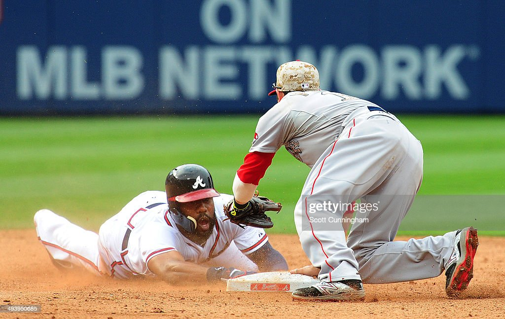 Jason Heyward #22 of the Atlanta Braves is tagged out after over-running second base by Dustin Pedroia #15 of the Boston Red Sox during the 8th inning at Turner Field on May 26, 2014 in Atlanta, Georgia.