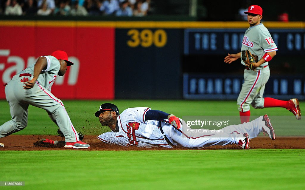 <a gi-track='captionPersonalityLinkClicked' href=/galleries/search?phrase=Jason+Heyward&family=editorial&specificpeople=5043351 ng-click='$event.stopPropagation()'>Jason Heyward</a> #22 of the Atlanta Braves is tagged out on a steal attempt at second base by <a gi-track='captionPersonalityLinkClicked' href=/galleries/search?phrase=Jimmy+Rollins&family=editorial&specificpeople=204478 ng-click='$event.stopPropagation()'>Jimmy Rollins</a> #11 of the Philadelphia Phillies at Turner Field on May 2, 2012 in Atlanta, Georgia.