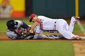 Jason Heyward of the Atlanta Braves is tagged out while colliding with Kevin Frandsen of the Philadelphia Phillies in the sixth inning during a...