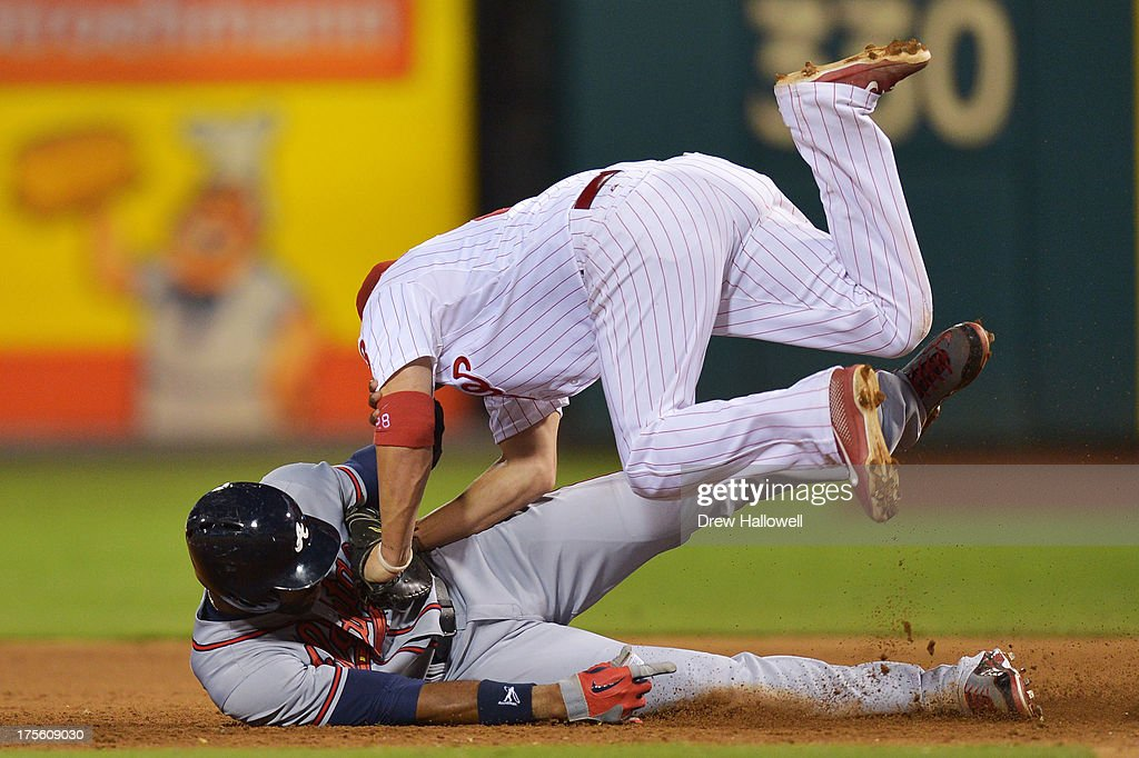 <a gi-track='captionPersonalityLinkClicked' href=/galleries/search?phrase=Jason+Heyward&family=editorial&specificpeople=5043351 ng-click='$event.stopPropagation()'>Jason Heyward</a> #22 of the Atlanta Braves is tagged out while colliding with <a gi-track='captionPersonalityLinkClicked' href=/galleries/search?phrase=Kevin+Frandsen&family=editorial&specificpeople=3982842 ng-click='$event.stopPropagation()'>Kevin Frandsen</a> #28 of the Philadelphia Phillies in the sixth inning during a rundown at Citizens Bank Park on August 4, 2013 in Philadelphia, Pennsylvania. The Braves won 4-1.