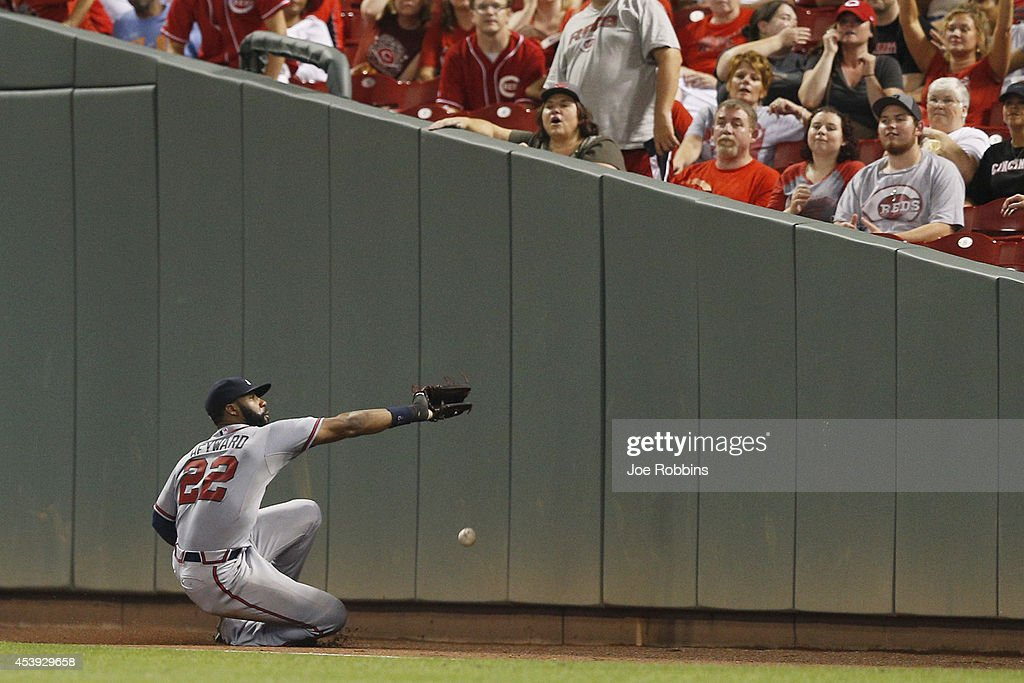 Jason Heyward #22 of the Atlanta Braves is unable to catch a foul ball near the right field wall in the sixth inning of the game against the Cincinnati Reds at Great American Ball Park on August 21, 2014 in Cincinnati, Ohio.