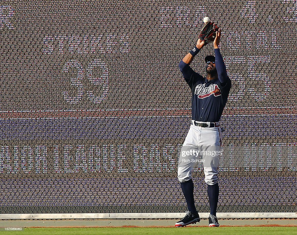 <a gi-track='captionPersonalityLinkClicked' href=/galleries/search?phrase=Jason+Heyward&family=editorial&specificpeople=5043351 ng-click='$event.stopPropagation()'>Jason Heyward</a> #22 of the Atlanta Braves makes a catch on a fly ball hit by Carlos Ruiz #51 of the Philadelphia Phillies during the fourth inning of a MLB baseball game on September 22, 2012 at Citizens Bank Park in Philadelphia, Pennsylvania. The Braves defeated the Phillies 8-2.
