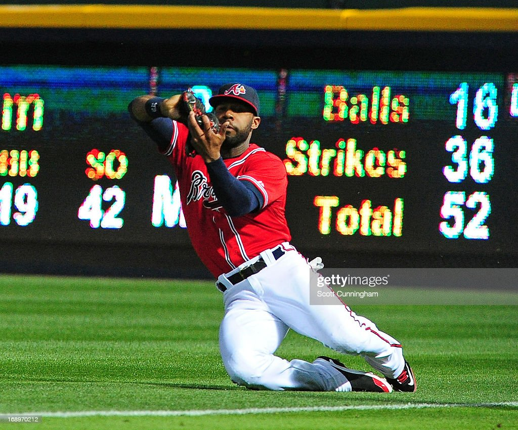 <a gi-track='captionPersonalityLinkClicked' href=/galleries/search?phrase=Jason+Heyward&family=editorial&specificpeople=5043351 ng-click='$event.stopPropagation()'>Jason Heyward</a> #22 of the Atlanta Braves makes a sliding catch against the Los Angeles Dodgers at Turner Field on May 17, 2013 in Atlanta, Georgia.