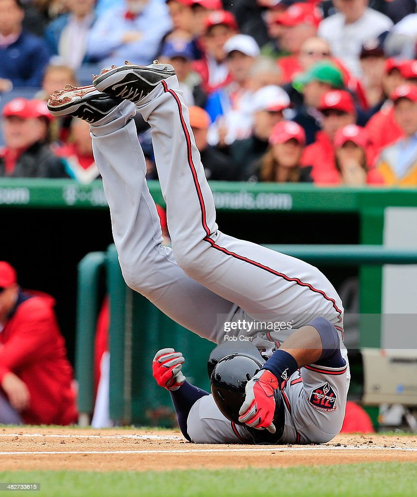 Jason Heyward #22 of the Atlanta Braves reacts after being hit by a pitch during the third inning against the Washington Nationals during the Nationals home opener at Nationals Park on April 4, 2014 in Washington, DC.