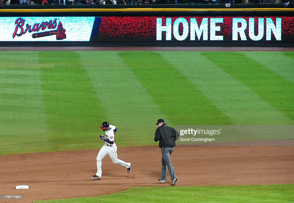 <a gi-track='captionPersonalityLinkClicked' href=/galleries/search?phrase=Jason+Heyward&family=editorial&specificpeople=5043351 ng-click='$event.stopPropagation()'>Jason Heyward</a> #22 of the Atlanta Braves rounds the bases after hitting a two-run ninth inning home run to tie the game against the Washington Nationals at Turner Field on August 17, 2013 in Atlanta, Georgia.