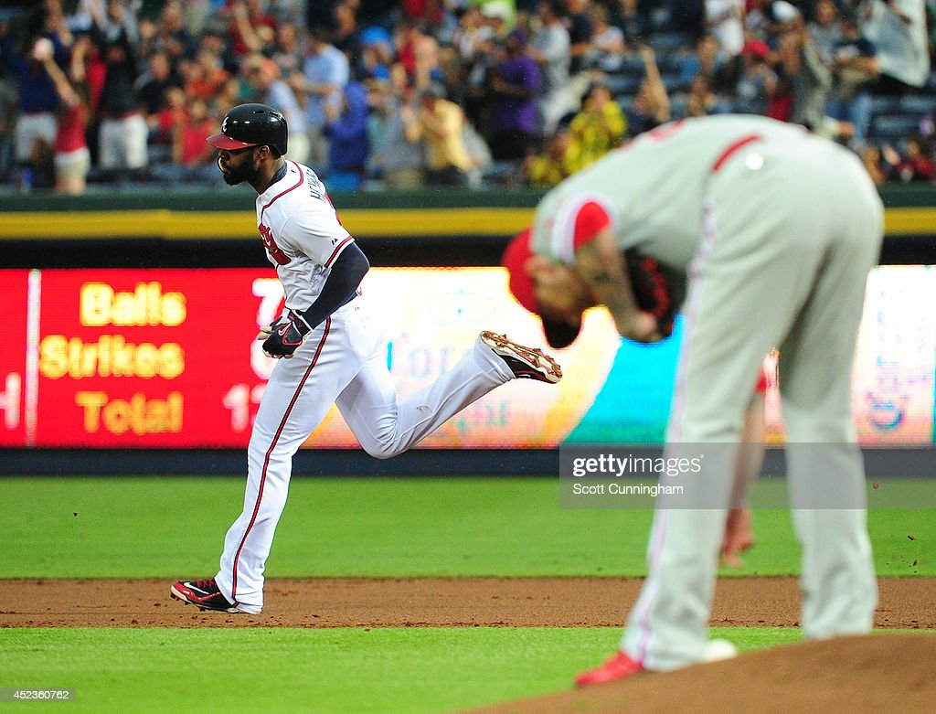 <a gi-track='captionPersonalityLinkClicked' href=/galleries/search?phrase=Jason+Heyward&family=editorial&specificpeople=5043351 ng-click='$event.stopPropagation()'>Jason Heyward</a> #22 of the Atlanta Braves rounds the bases after hitting a second inning solo home run against A. J. Burnett #34 of the Philadelphia Phillies at Turner Field on July 18, 2014 in Atlanta, Georgia.