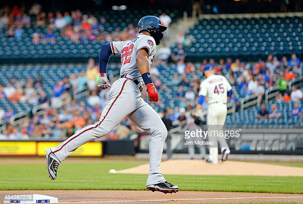 Jason Heyward of the Atlanta Braves runs the bases after his first inning home run against Zack Wheeler of the New York Mets at Citi Field on August...