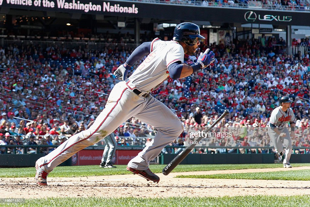 <a gi-track='captionPersonalityLinkClicked' href=/galleries/search?phrase=Jason+Heyward&family=editorial&specificpeople=5043351 ng-click='$event.stopPropagation()'>Jason Heyward</a> #22 of the Atlanta Braves runs to first base after hitting into an RBI fielder's choice scoring scoring Chris Johnson #23 (R) during the ninth inning of the Braves 3-1 win over the Washington Nationals at Nationals Park on April 13, 2013 in Washington, DC.