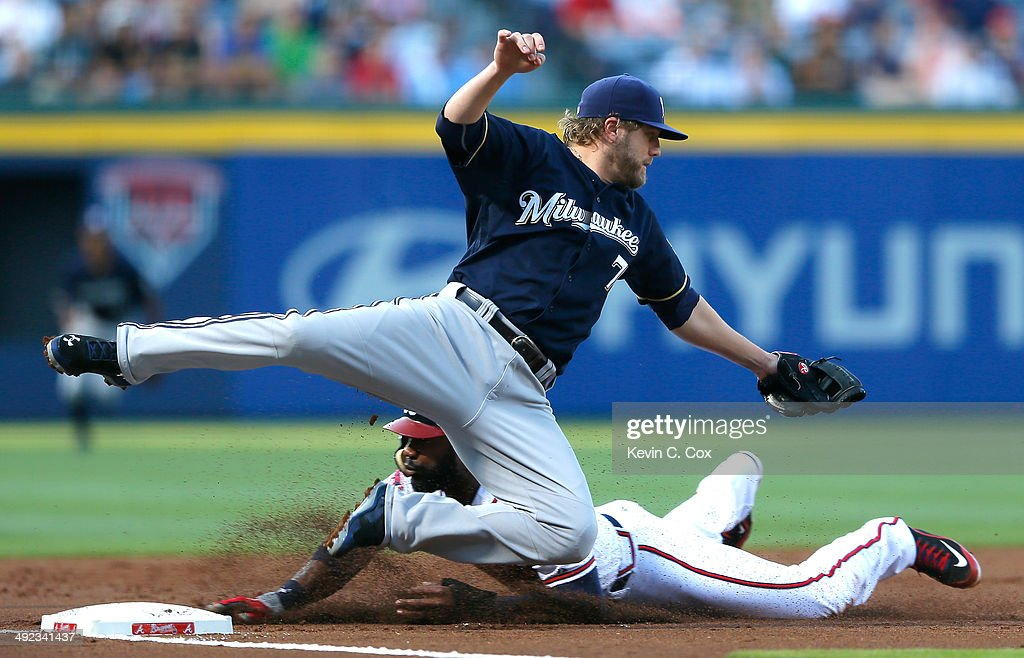 <a gi-track='captionPersonalityLinkClicked' href=/galleries/search?phrase=Jason+Heyward&family=editorial&specificpeople=5043351 ng-click='$event.stopPropagation()'>Jason Heyward</a> #22 of the Atlanta Braves slides safely into third base as <a gi-track='captionPersonalityLinkClicked' href=/galleries/search?phrase=Mark+Reynolds&family=editorial&specificpeople=2343799 ng-click='$event.stopPropagation()'>Mark Reynolds</a> #7 of the Milwaukee Brewers dives for a wild throw by Martin Maldonado #12 in the first inning at Turner Field on May 19, 2014 in Atlanta, Georgia. Heyward scored on the throwing error by Maldonado.