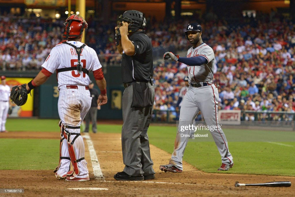 <a gi-track='captionPersonalityLinkClicked' href=/galleries/search?phrase=Jason+Heyward&family=editorial&specificpeople=5043351 ng-click='$event.stopPropagation()'>Jason Heyward</a> #22 of the Atlanta Braves tries to show Carlos Ruiz #51 of the Philadelphia Phillies and the home plate umpire his arm after getting hit by a pitch in the sixth inning at Citizens Bank Park on August 4, 2013 in Philadelphia, Pennsylvania. The Braves won 4-1.