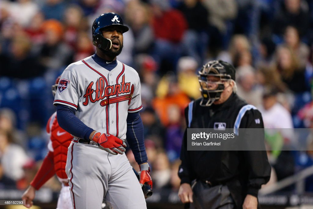 <a gi-track='captionPersonalityLinkClicked' href=/galleries/search?phrase=Jason+Heyward&family=editorial&specificpeople=5043351 ng-click='$event.stopPropagation()'>Jason Heyward</a> of the Atlanta Braves walks back to the dugout after striking out in the third inning of the game against the Philadelphia Phillies at Citizens Bank Park on April 16, 2014 in Philadelphia, Pennsylvania. All uniformed team members are wearing jersey number 42 in honor of Jackie Robinson Day. The Braves won 1-0.
