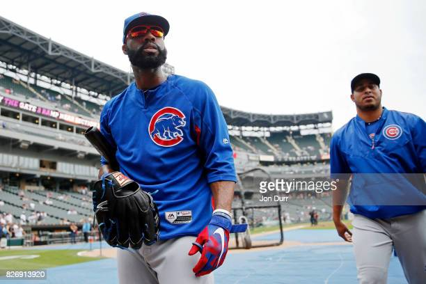 Jason Heyward of the Chicago Cubs and Hector Rondon walk to the dugout after warming up before the game against the Chicago White Sox at Guaranteed...