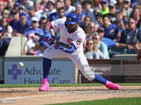 Jason Heyward of the Chicago Cubs bunts against the Washington Nationals at Wrigley Field on May 8 2016 in Chicago Illinois The Cubs defeated the...