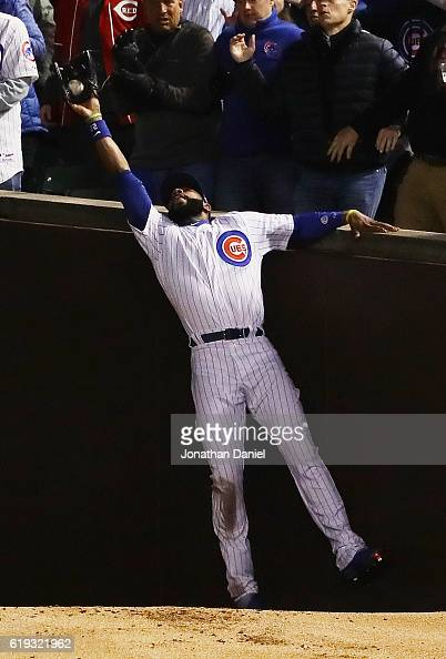 Jason Heyward of the Chicago Cubs catches a foul ball in the third inning against the Cleveland Indians in Game Five of the 2016 World Series at...