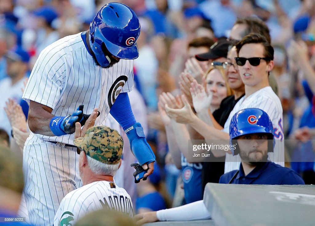 Jason Heyward #22 of the Chicago Cubs is congratulated by manager Joe Maddon #70 after scoring off of an RBI double by Anthony Rizzo #44 (not pictured) against the Los Angeles Dodgers during the fifth inning at Wrigley Field on May 30, 2016 in Chicago, Illinois.