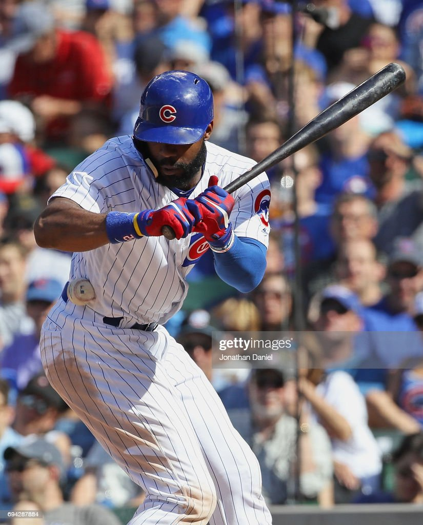 Jason Heyward #22 of the Chicago Cubs is hit in the side by a pitch in the 8th inning against the Colorado Rockies at Wrigley Field on June 9, 2017 in Chicago, Illinois. The Rockies defeated the Cubs 5-3.