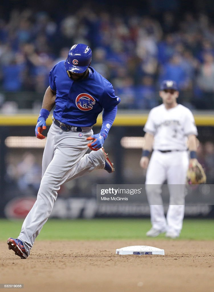 Jason Heyward of the Chicago Cubs runs the bases after hitting a solo home run in the ninth inning against the Milwaukee Brewers at Miller Park on...