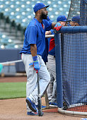 Jason Heyward of the Chicago Cubs waits for his turn during batting practice before the game against the Milwaukee Brewers at Miller Park on July 22...