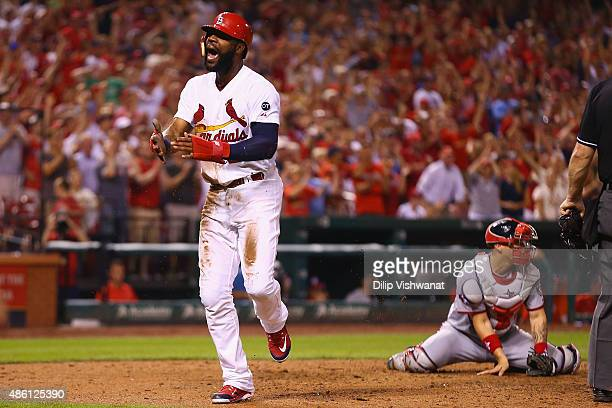 Jason Heyward of the St Louis Cardinals celebrates after scoring a run against the Washington Nationals in the seventh inning at Busch Stadium on...