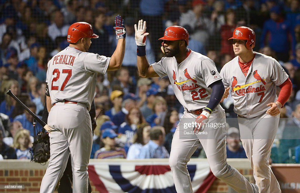 <a gi-track='captionPersonalityLinkClicked' href=/galleries/search?phrase=Jason+Heyward&family=editorial&specificpeople=5043351 ng-click='$event.stopPropagation()'>Jason Heyward</a> #22 of the St. Louis Cardinals celebrates with <a gi-track='captionPersonalityLinkClicked' href=/galleries/search?phrase=Jhonny+Peralta&family=editorial&specificpeople=213286 ng-click='$event.stopPropagation()'>Jhonny Peralta</a> #27 of the St. Louis Cardinals after hitting a two-run home run in the sixth inning against the Chicago Cubs during game three of the National League Division Series at Wrigley Field on October 12, 2015 in Chicago, Illinois.