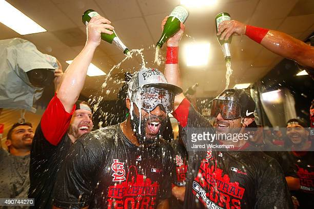 Jason Heyward of the St Louis Cardinals celebrates with teammates in the clubhouse following their division clinching 111 win against the Pittsburgh...