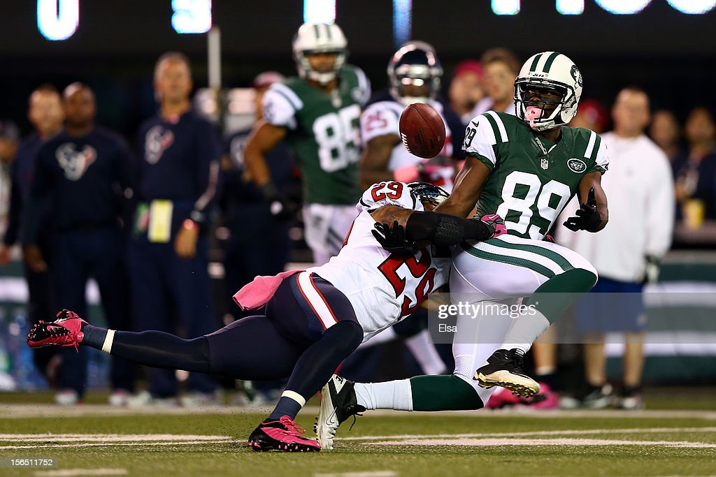 Jason Hill #89 of the New York Jets fails to catch a pass thrown by <a gi-track='captionPersonalityLinkClicked' href=/galleries/search?phrase=Tim+Tebow&family=editorial&specificpeople=2729658 ng-click='$event.stopPropagation()'>Tim Tebow</a> #15 (not pictured) against <a gi-track='captionPersonalityLinkClicked' href=/galleries/search?phrase=Glover+Quin&family=editorial&specificpeople=5732643 ng-click='$event.stopPropagation()'>Glover Quin</a> #29 of the Houston Texans at MetLife Stadium on October 8, 2012 in East Rutherford, New Jersey.