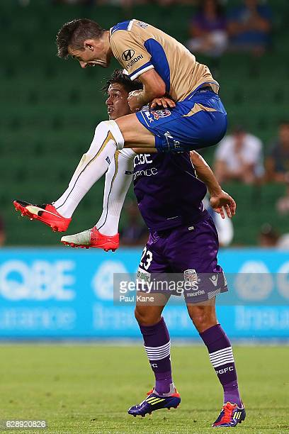 Jason Hoffman of the Jets and Kosta Petratos of the Glory contest a header during the round 10 ALeague match between the Perth Glory and the...