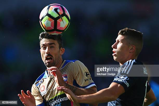 Jason Hoffman of the Jets competes for the ball during the round eight ALeague match between Melbourne Victory and the Newcastle Jets at AAMI Park on...